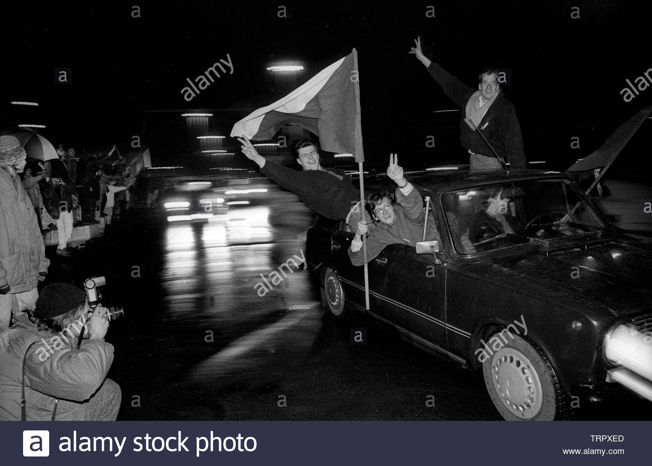 Czechoslovakia, Prague,1989 during the Velvet Revolution, the fall of communism in Eastern Europe. Celebrating the fall of the communist government by driving around Wenceslas Square showing the Czech flag. COPYRIGHT PHOTOGRAPH BY BRIAN HARRIS  © 07808-579804 Stock Photo