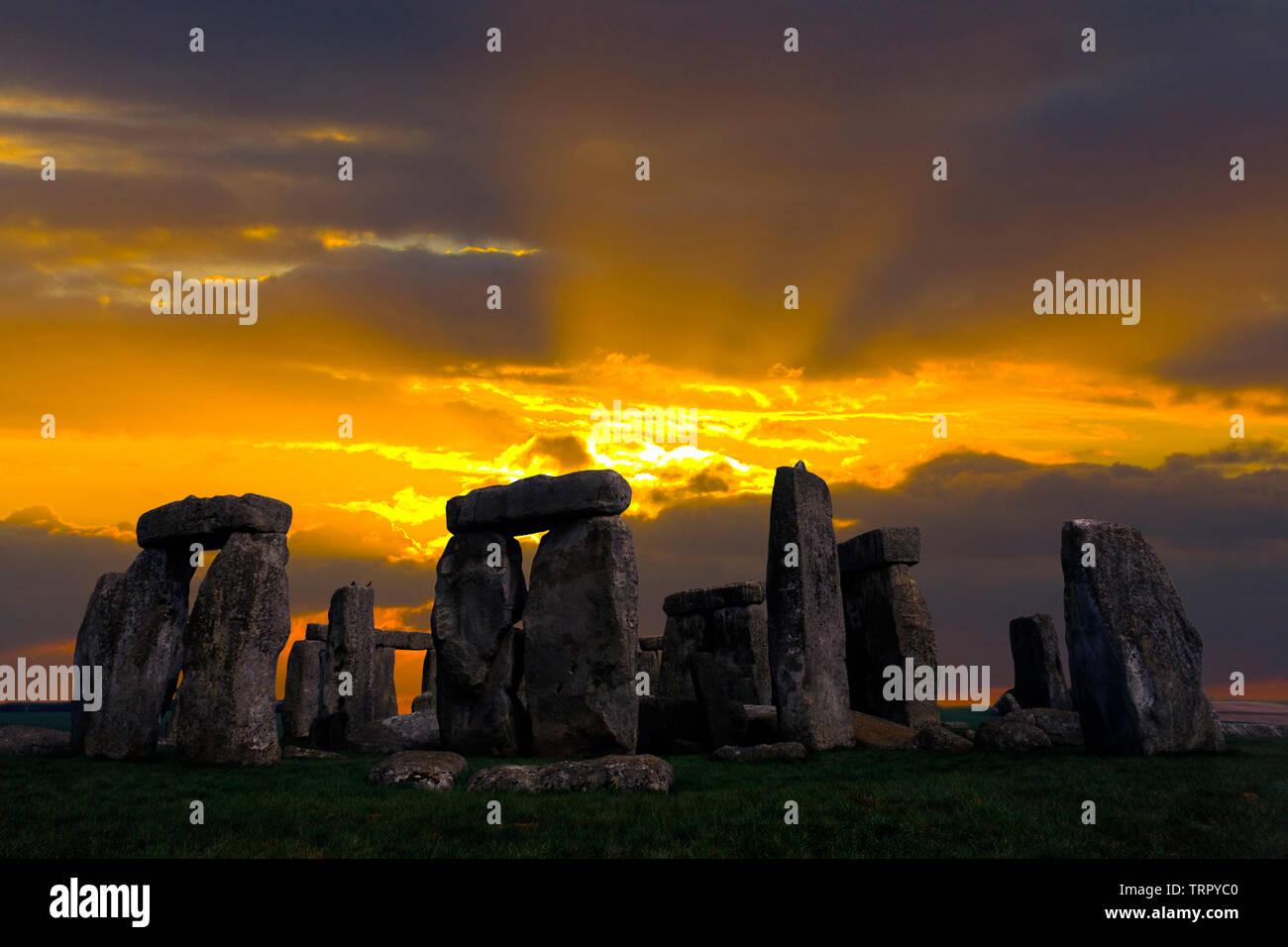 Amesbury,ancient,Solstice, Sunrise,sun,beams,Neolithic, Stone, Circle, Stonehenge, Wiltshire, England, UK, Stock Photo