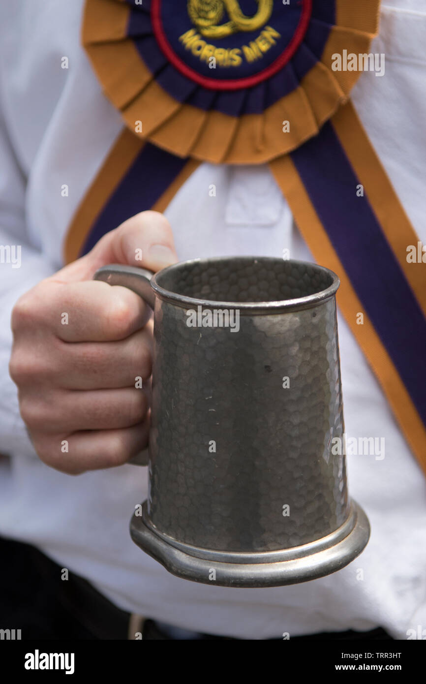 Pint of beer in a traditional pewter tankard Morris Dancers 2010s UK HOMER SYKES - Stock Image