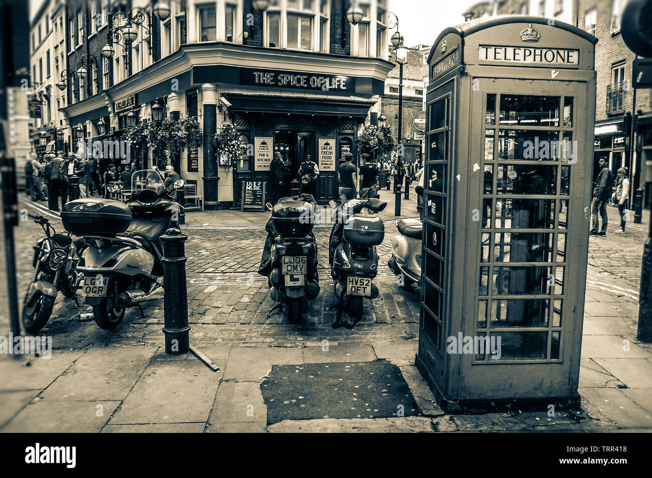 Telephone cabin in front of 'The Spice of Life', London, UK - Stock Image