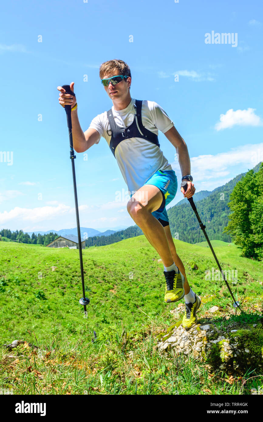Arduous trail running exercise in alpine region - Stock Image