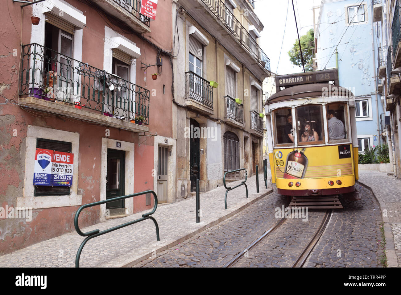 28E tram, much used by tourists, Alfama, Lisbon, Portugal, June 2019 - Stock Image