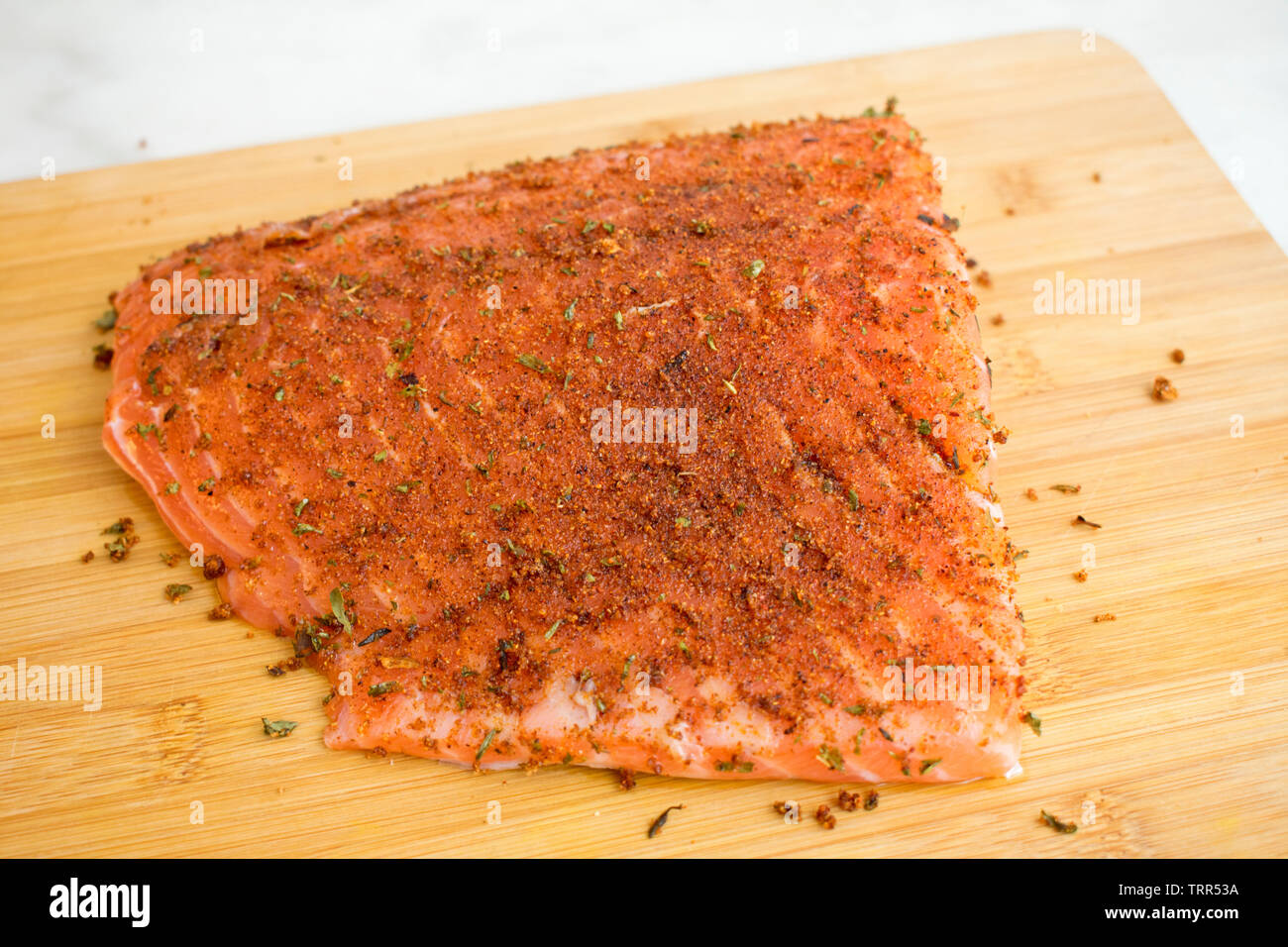 Seasoning Salmon Fillet with Jamaican Jerk Spices - Stock Image