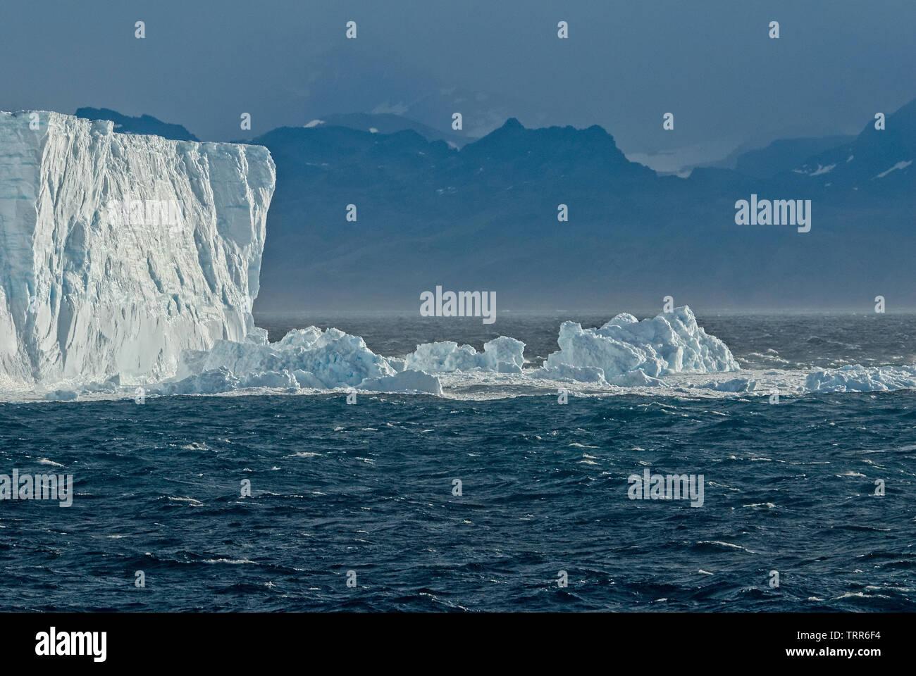 Cleaving iceberg off the coast of South Georgia Antartica Stock Photo
