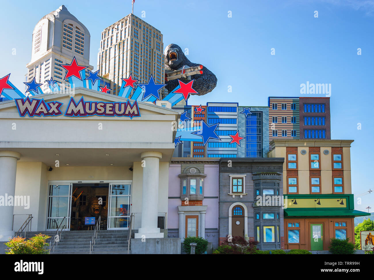 Pigeon Forge, Tennessee,USA - May 15,2019:  Hollywood Wax Museum is a tourist attraction form the outside as King Kong holding a bi-plane climbs a sky - Stock Image