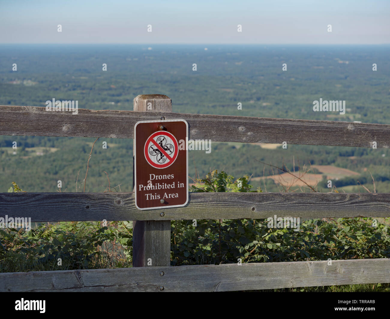 Drones Prohibited sign on fence in North Carolina state park. Pilot Mountain State Park, NC. Drone regulation. - Stock Image