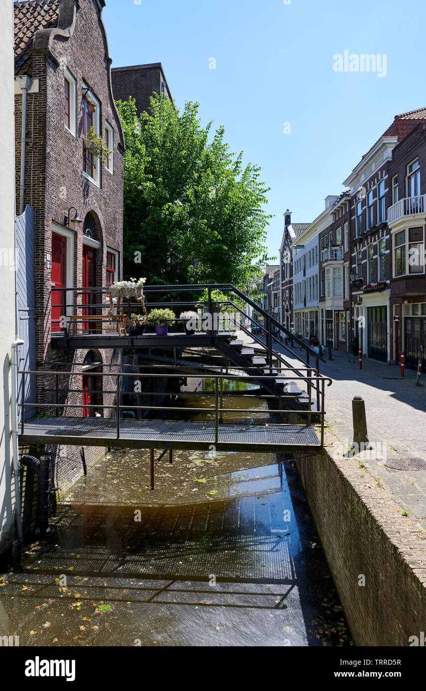 Canal with small bridges in dutch city Gouda, Netherlands - Stock Image