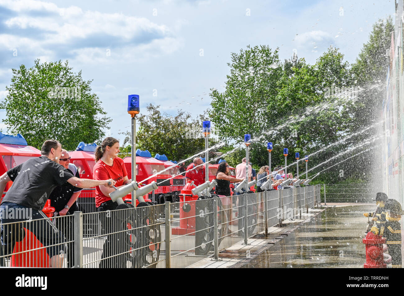 Fireman challenge for kids and parents at Legoland in Billund. This family theme park opened in 1968 and is built by 65 million lego bricks. - Stock Image