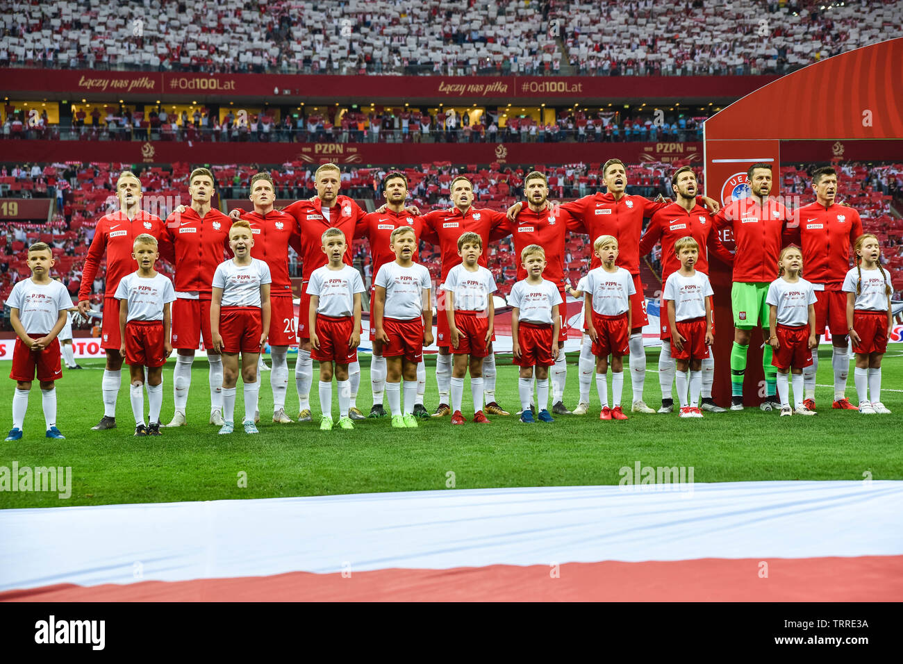 WARSAW, POLAND - JUNE 10, 2019: Qualifications Euro 2020  match Poland - Israel 4:0. Team of Poland during anthem. - Stock Image