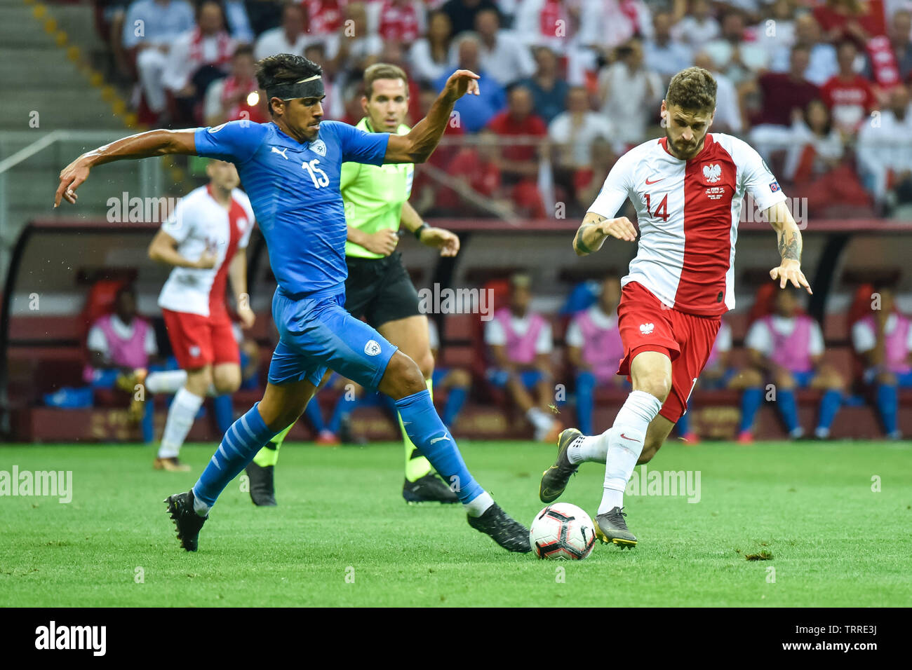 WARSAW, POLAND - JUNE 10, 2019: Qualifications Euro 2020  match Poland - Israel 4:0. In action Dor Peretz (L) and Mateusz Klich (R). - Stock Image