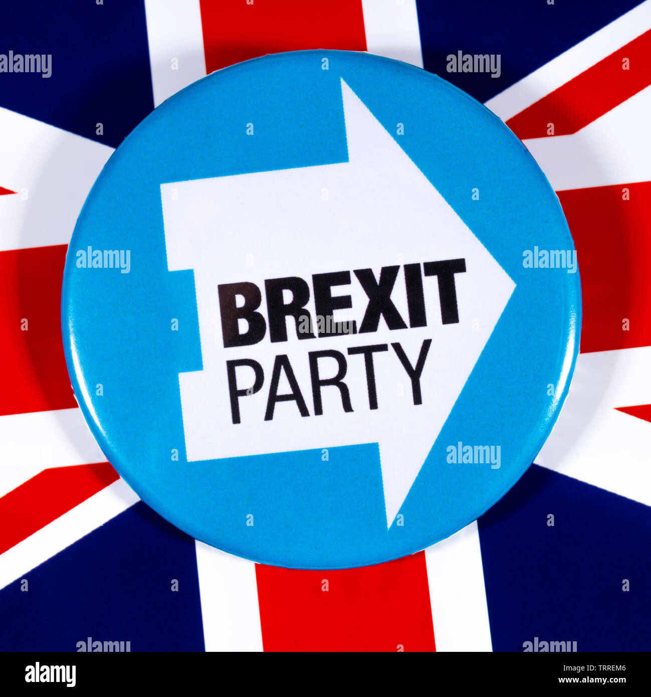 London, UK - May 29th 2019: A pin badge for the Brexit Party, pictured over the UK flag.  The Brexit Party are a UK political party led by Nigel Farag - Stock Image