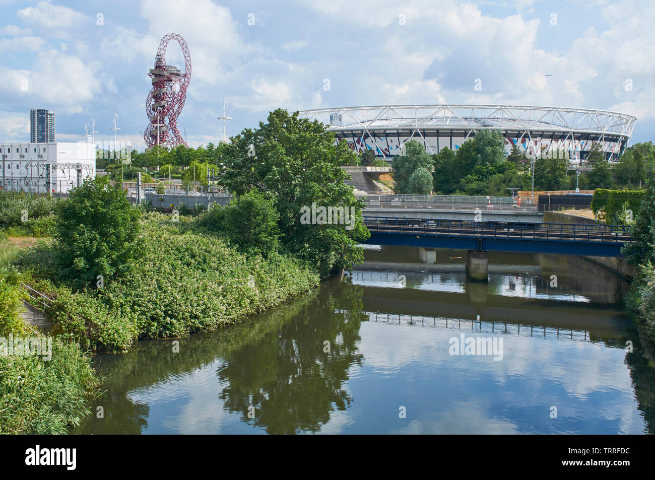 The River Lea at London Olympic Park, with the London Stadium and the ArcelorMittal Orbit in background Stock Photo