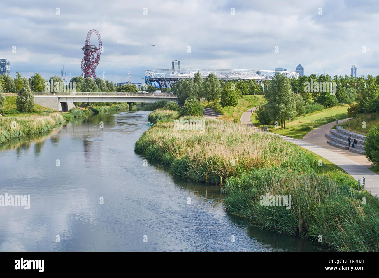 The Northern Parklands in London Olympic Park, looking along the River Lea towards the London Stadium and the ArcelorMittal Orbit Stock Photo