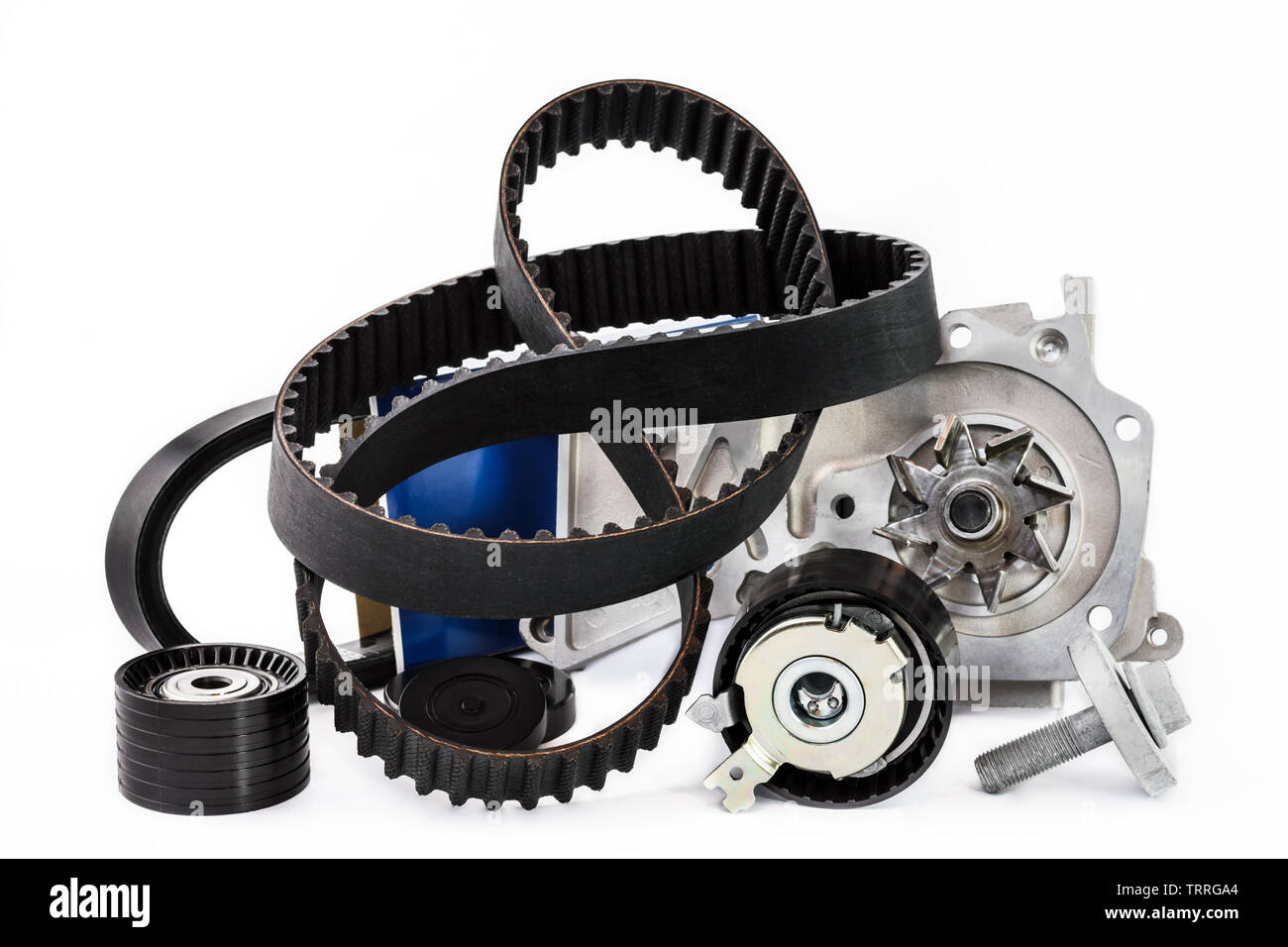 Spare parts for the car. The set of timing belt with rollers and cooling pump on a white background. - Stock Image