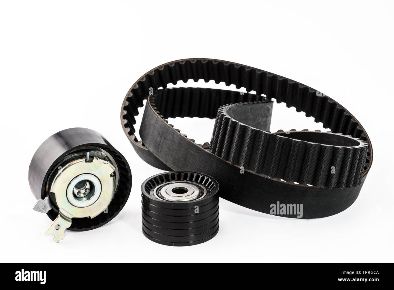 Spare parts for the car. The set of timing belt with rollers on a white background. - Stock Image