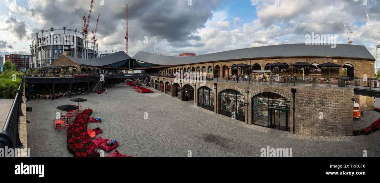 London, England, UK - June 3, 2019: People browse shops and resturants in the newly redeveloped Coal Drops Yard in the King's Cross regeneration neigh - Stock Image