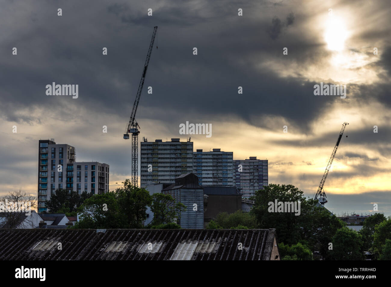 London, England, UK - June 1, 2019: The sun sets behind the remaining tower blocks of the Alma Estate during regeneration of the housing in the Ponder Stock Photo