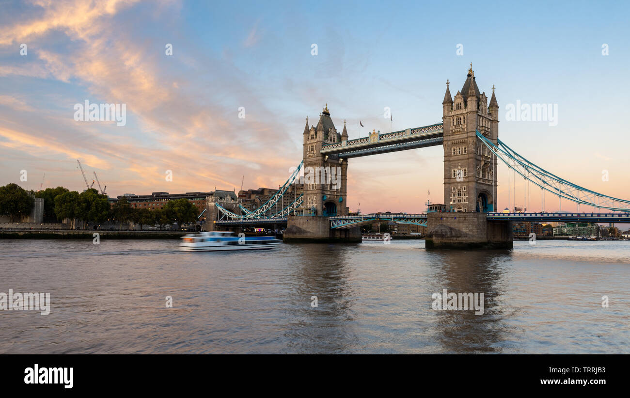 London, England, UK - September 27, 2018: Clouds light up over London's iconic Tower Bridge at sunset. Stock Photo