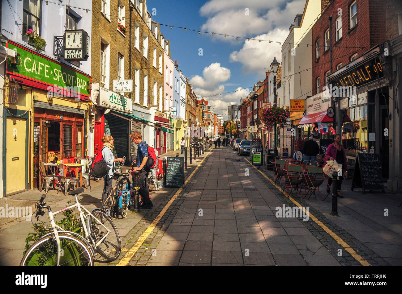 London, England, UK - September 18, 2011: Sun shines on the independent shops and cafes of Exmouth Market in central London. Stock Photo
