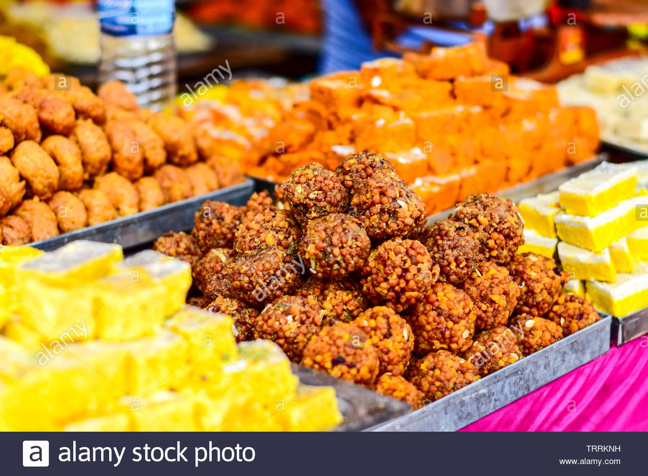 Indian sweet desserts are selling in local market. - Stock Image
