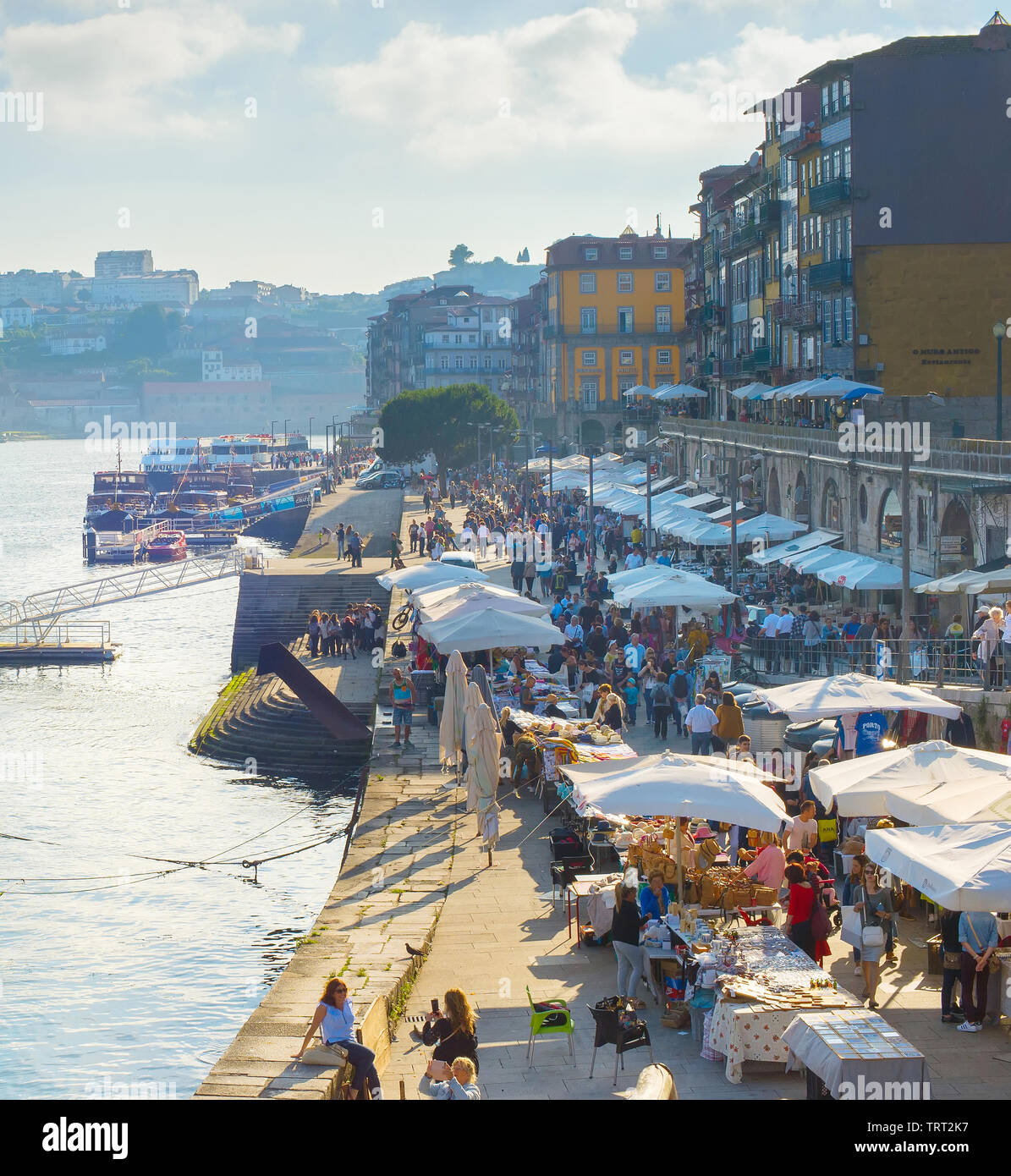 PORTO, PORTUGAL - JUNE 2, 2017: Cityscape with Porto Old Town quay, outdoor restaurants, souvenir stalls, crowd of tourists - Stock Image