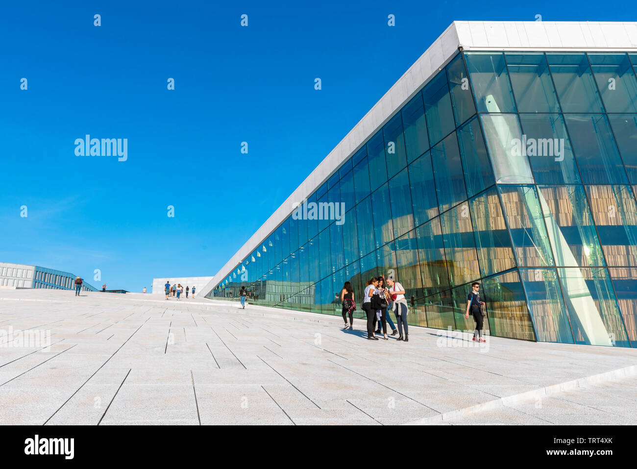 Opera House Oslo, view in summer of young people standing on the vast access ramp leading to the roof of the Oslo Opera House, Norway. Stock Photo