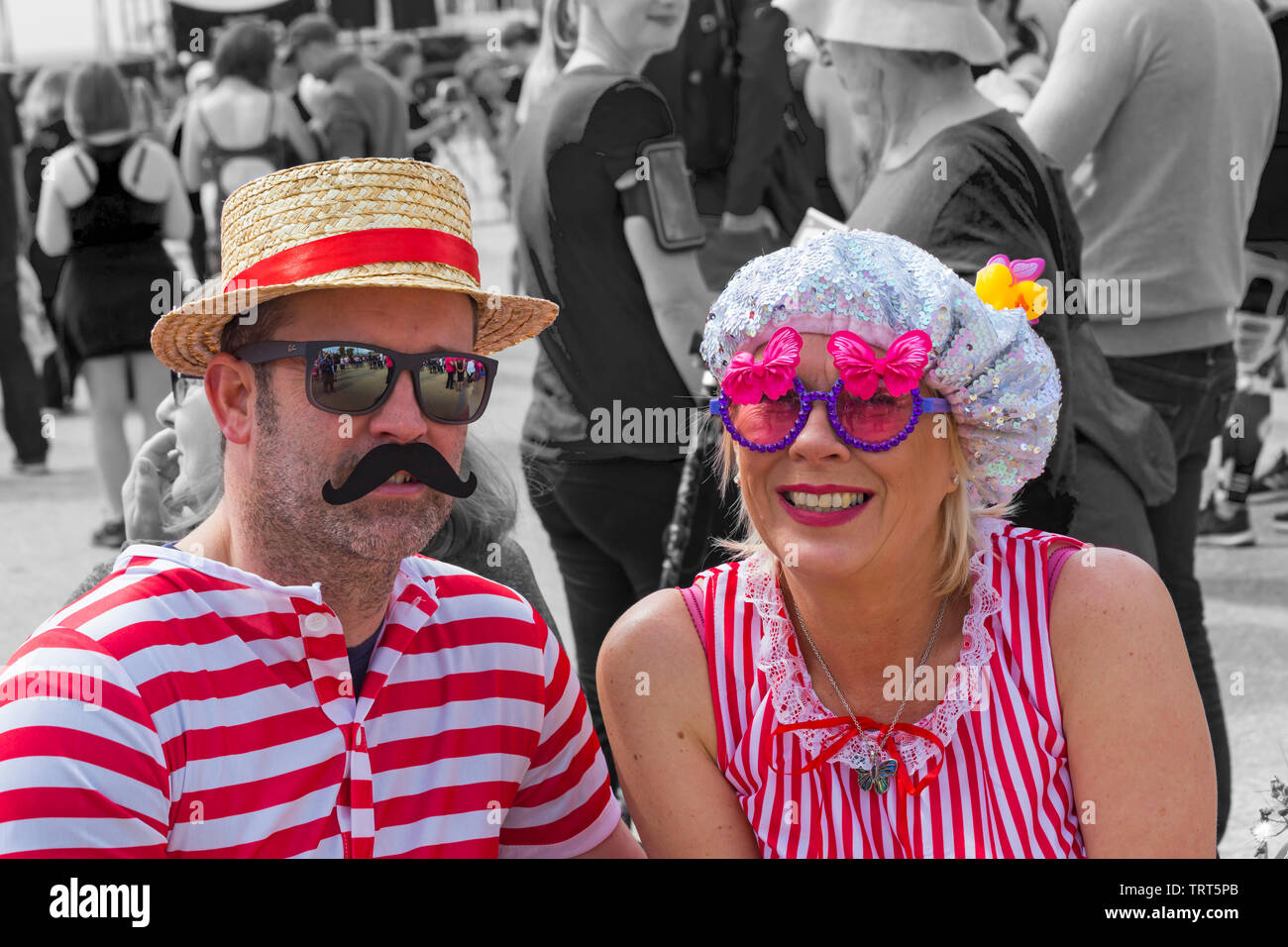 Couple dressed in Victorian bathing costumes for Race for Life at Bournemouth, Dorset UK in June - Stock Image