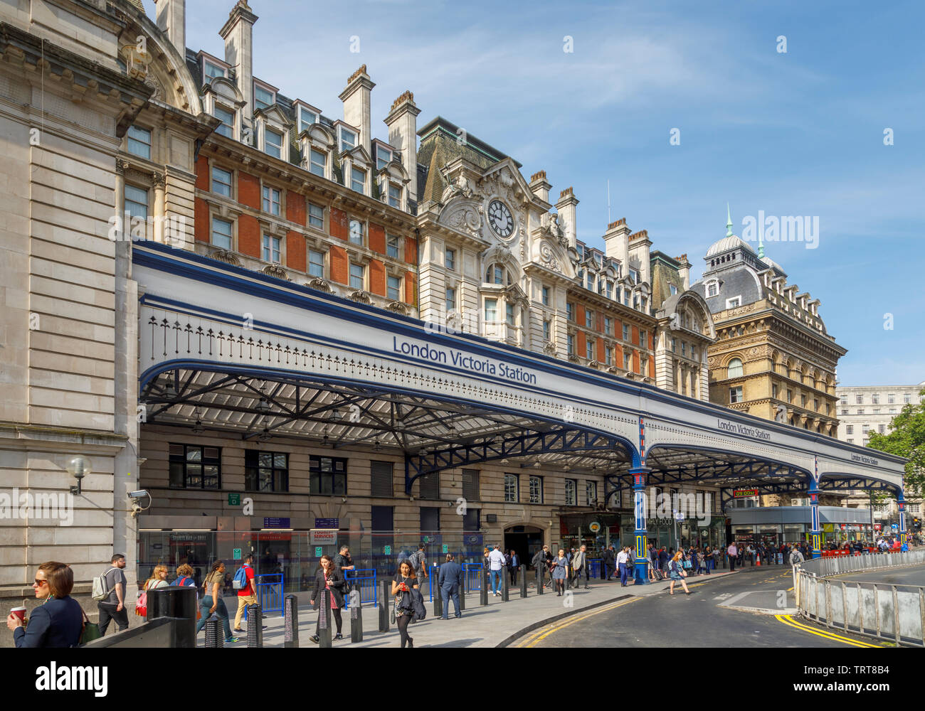 London cityscape: exterior façade and entrance canopy of London Victoria Station, City of Westminster, London, UK, a major transport terminus Stock Photo