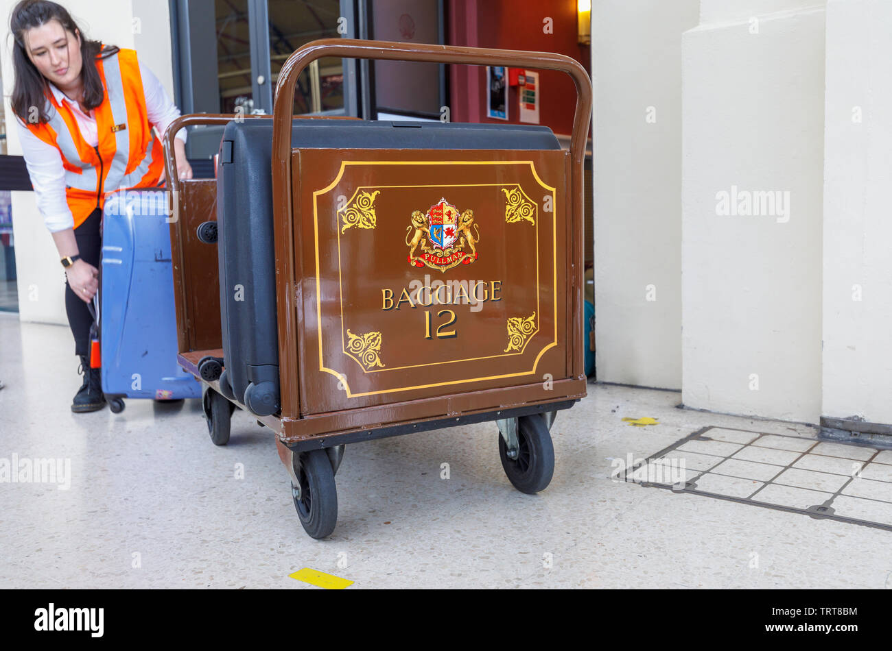 Pullman baggage luggage trolley with suitcases at the entrance to the Belmond Venice Simplon Orient Express departure lounge, London Victoria station Stock Photo