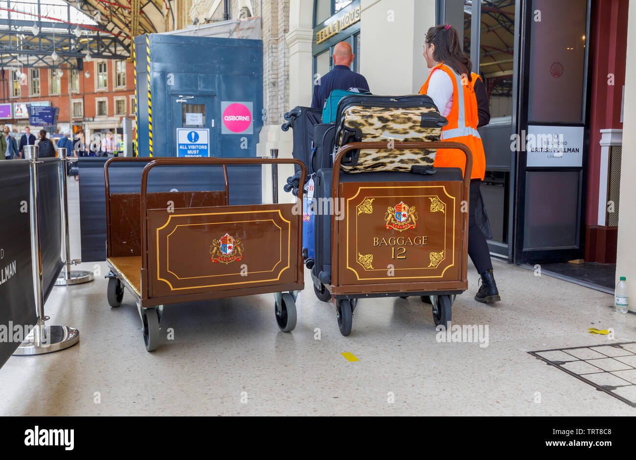 Pullman baggage luggage trollies with suitcases at the entrance to the Belmond Venice Simplon Orient Express departure lounge, London Victoria station Stock Photo