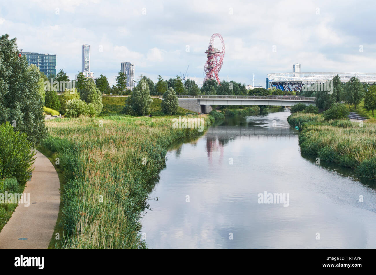The Northern Parklands in the London Olympic Park, Stratford, looking South towards the London Stadium, along the River Lea Stock Photo