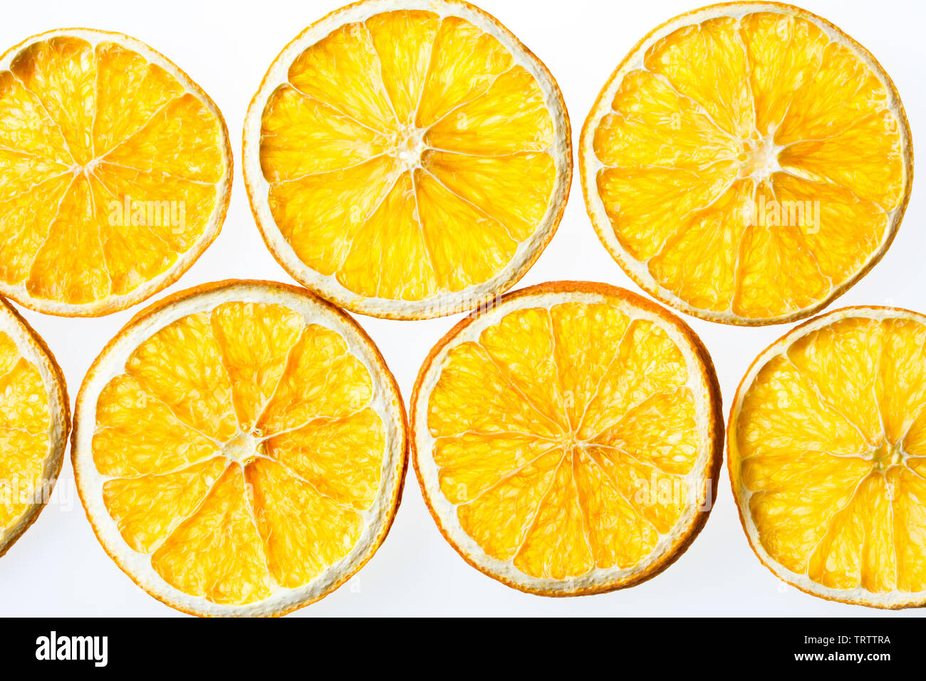 Dried orange slices isolated on white background - Stock Image