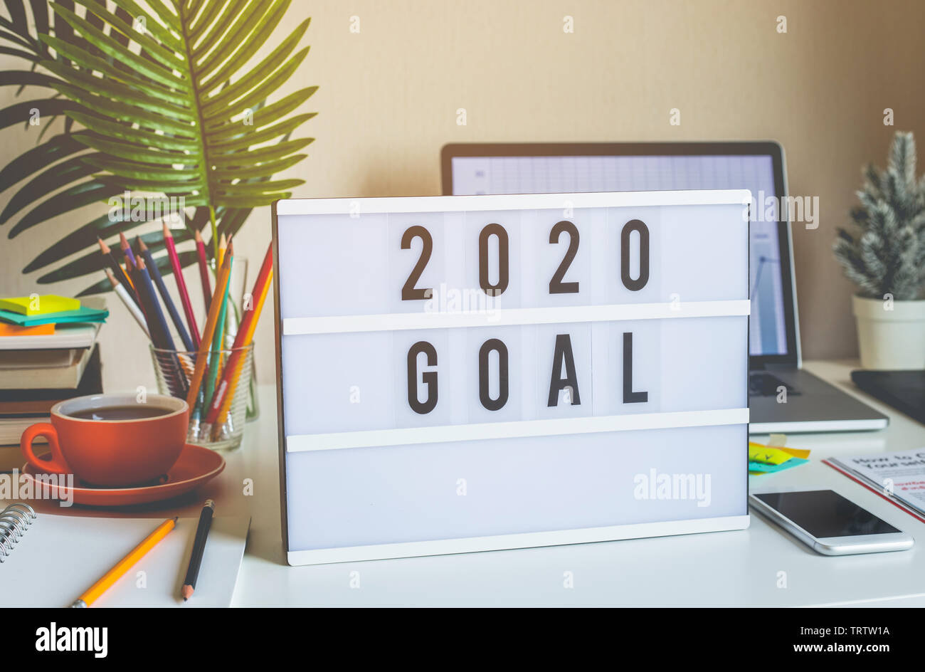 Business Use Of Home 2020.2020 New Year Goals Text On Light Box On Desk Table In