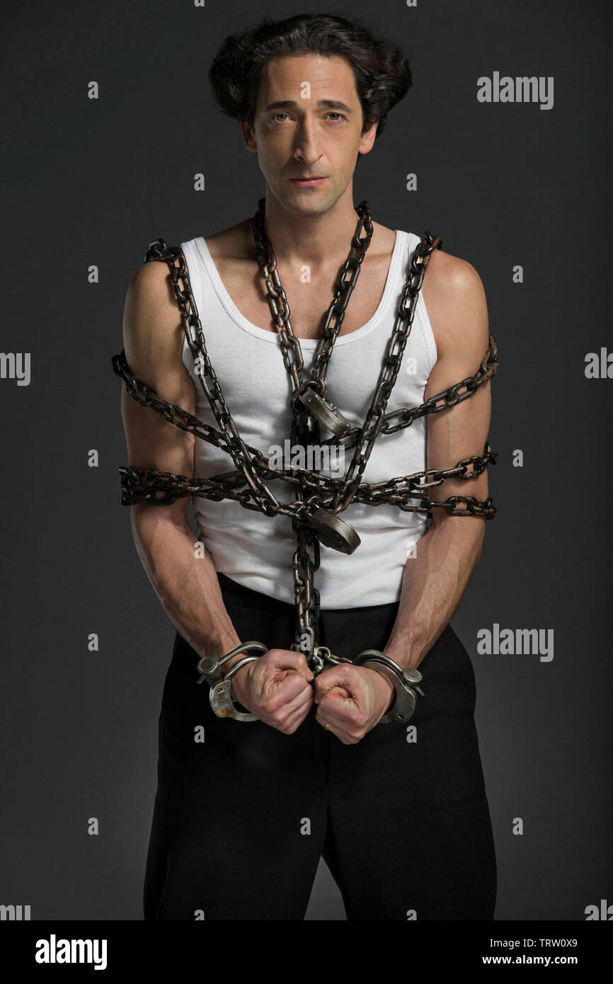 ADRIEN BRODY in HOUDINI (2014). Copyright: Editorial use only. No merchandising or book covers. This is a publicly distributed handout. Access rights only, no license of copyright provided. Only to be reproduced in conjunction with promotion of this film. Credit: LIONSGATE TELEVISION / Album - Stock Image