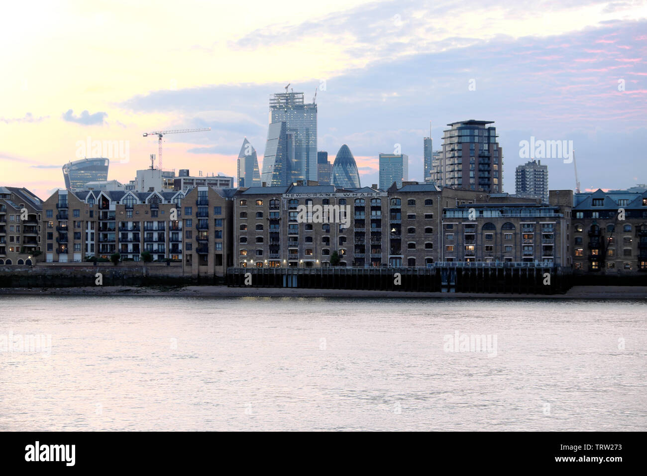 Thames homes apartments London living Wapping flats on river view from Rotherhithe and City of London skyscrapers England UK  KATHY DEWITT - Stock Image