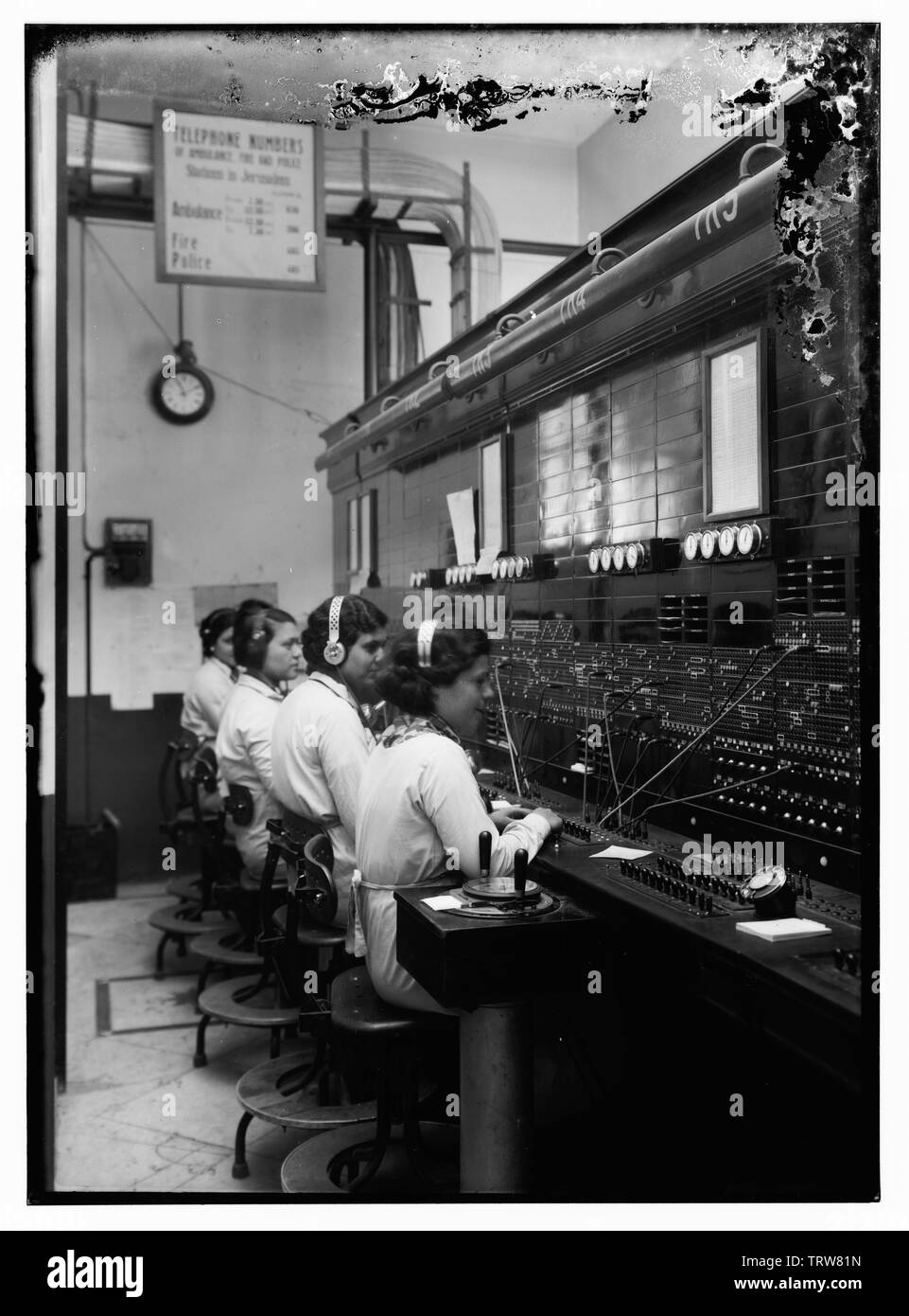 'English: Title: 4 women at tel. [i.e., telephone] switchboard Abstract/medium: G. Eric and Edith Matson Photograph Collection  Physical description: - Stock Image