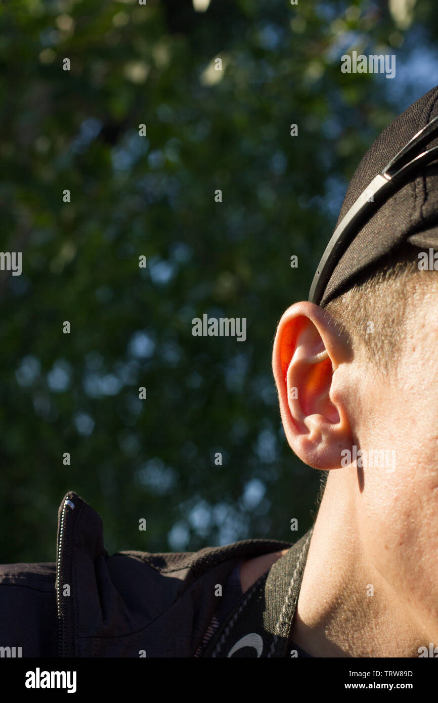part of a man's face , ear of a young man - Stock Image