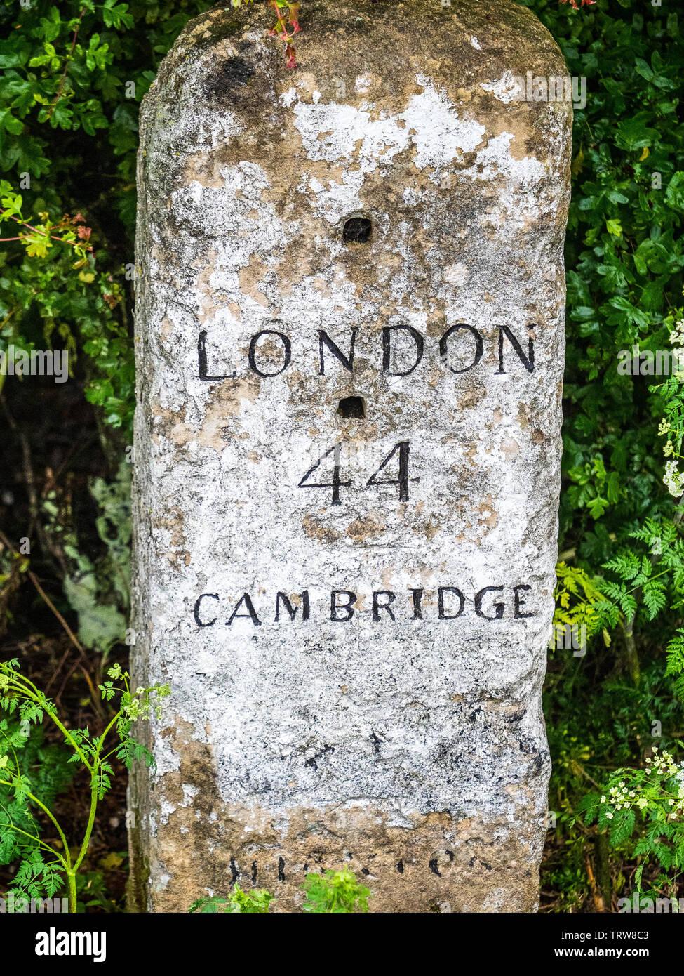 London to Cambridge Milestone, near Cambridge UK - Stock Image