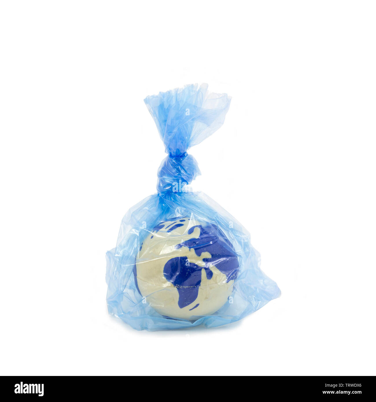 Earth globe inside a plastic bag, pollution and warming concept - Stock Image