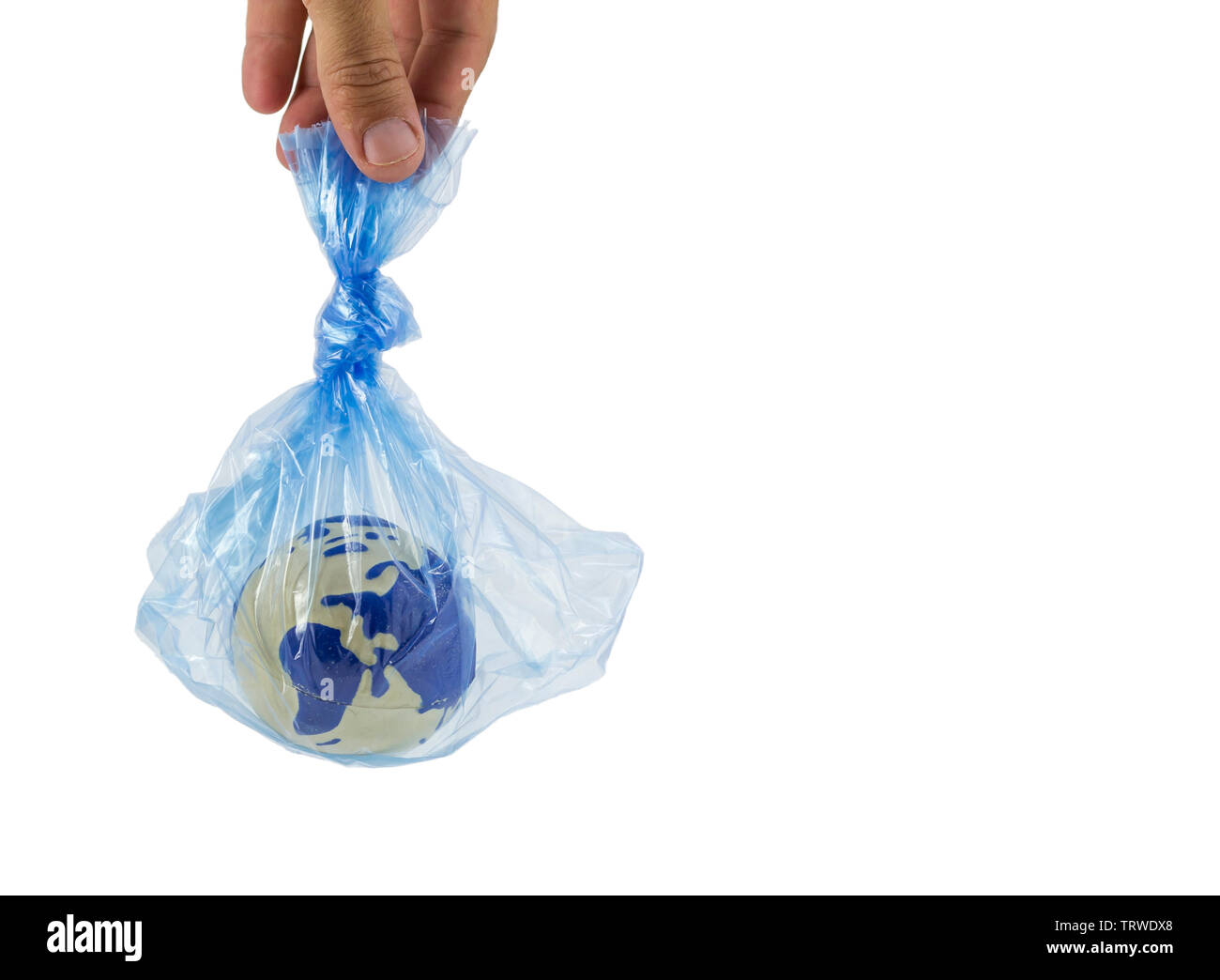 Human hand holding an earth globe inside a plastic bag, pollution and warming concept - Stock Image