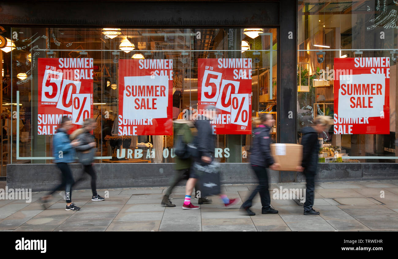 Manchester, UK. 12th June 2019. Urban Outfitters Summer Sale; People shops, sales, consumers, retail commercial businesses in the city centre. Credt;MediaWordlImages/AlamyLiveNews. - Stock Image