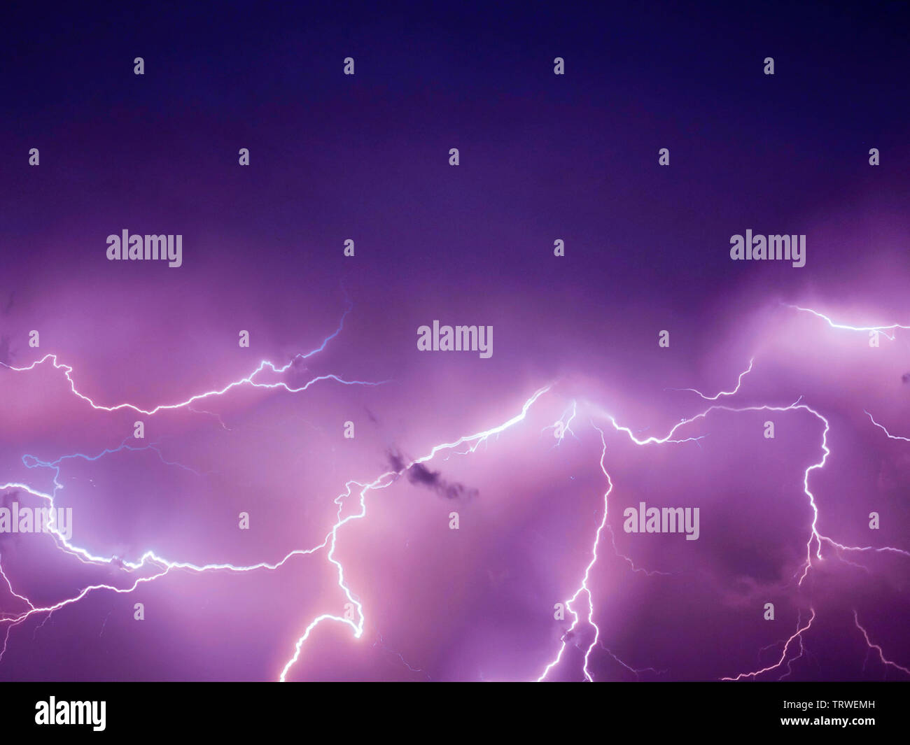 Lightning thunderstorm flash over the night sky. Concept on topic weather - - Stock Image
