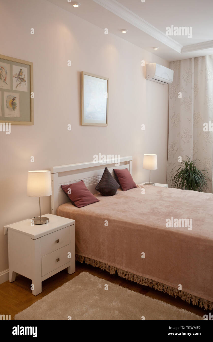 Epmty Minimalistic Interior Background Bedroom Of Modern Apartment With Double Bed Lights On Nobody With Copy Space Vertical Stock Photo Alamy