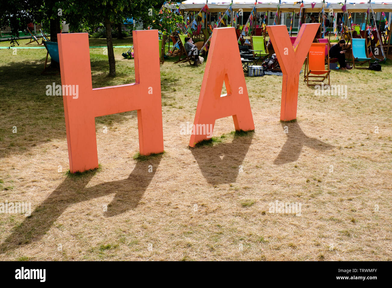The Large-lettered HAY sign at the Hay Literary Festival, Hay on Wye, Powys - Stock Image