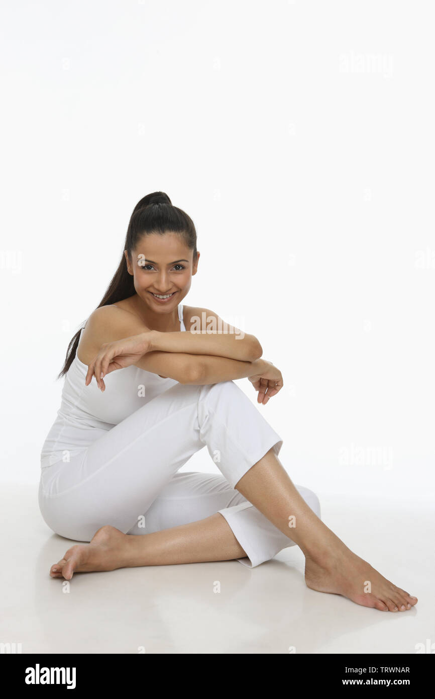Portrait of a woman sitting on a floor and smiling Stock Photo