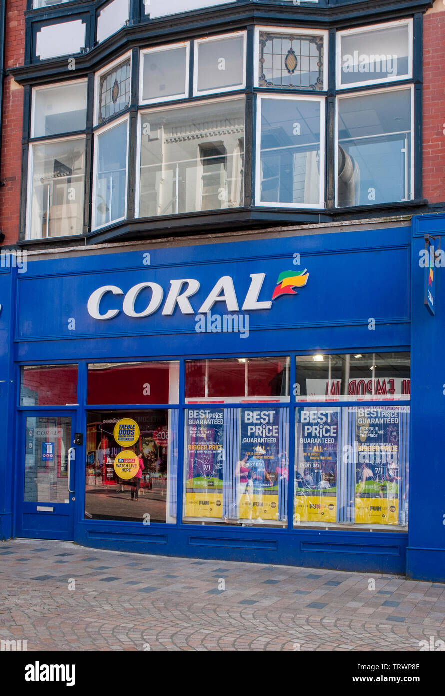 Shop frontage of Coral bookmakers betting shop  Modern front beneath older upper floor - Stock Image