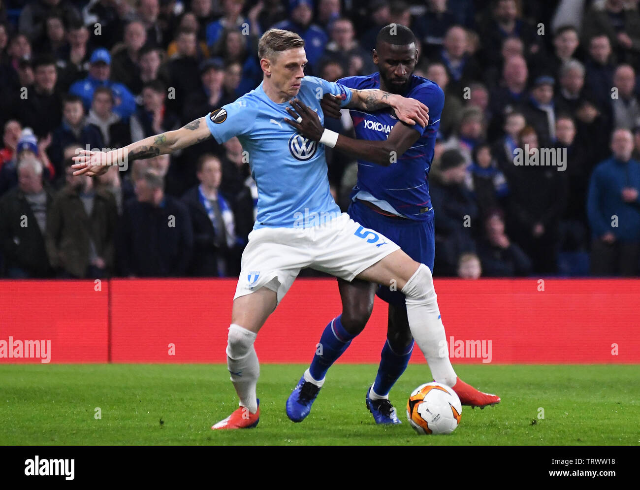 LONDON, ENGLAND - FEBRUARY 21, 2019: Soren Rieks of Malmo and Antonio Rudiger  of Chelsea pictured during the second leg of the 2018/19 UEFA Europa League Round of 32 game between Chelsea FC (England) and Malmo FF (Sweden) at Stamford Bridge. - Stock Image