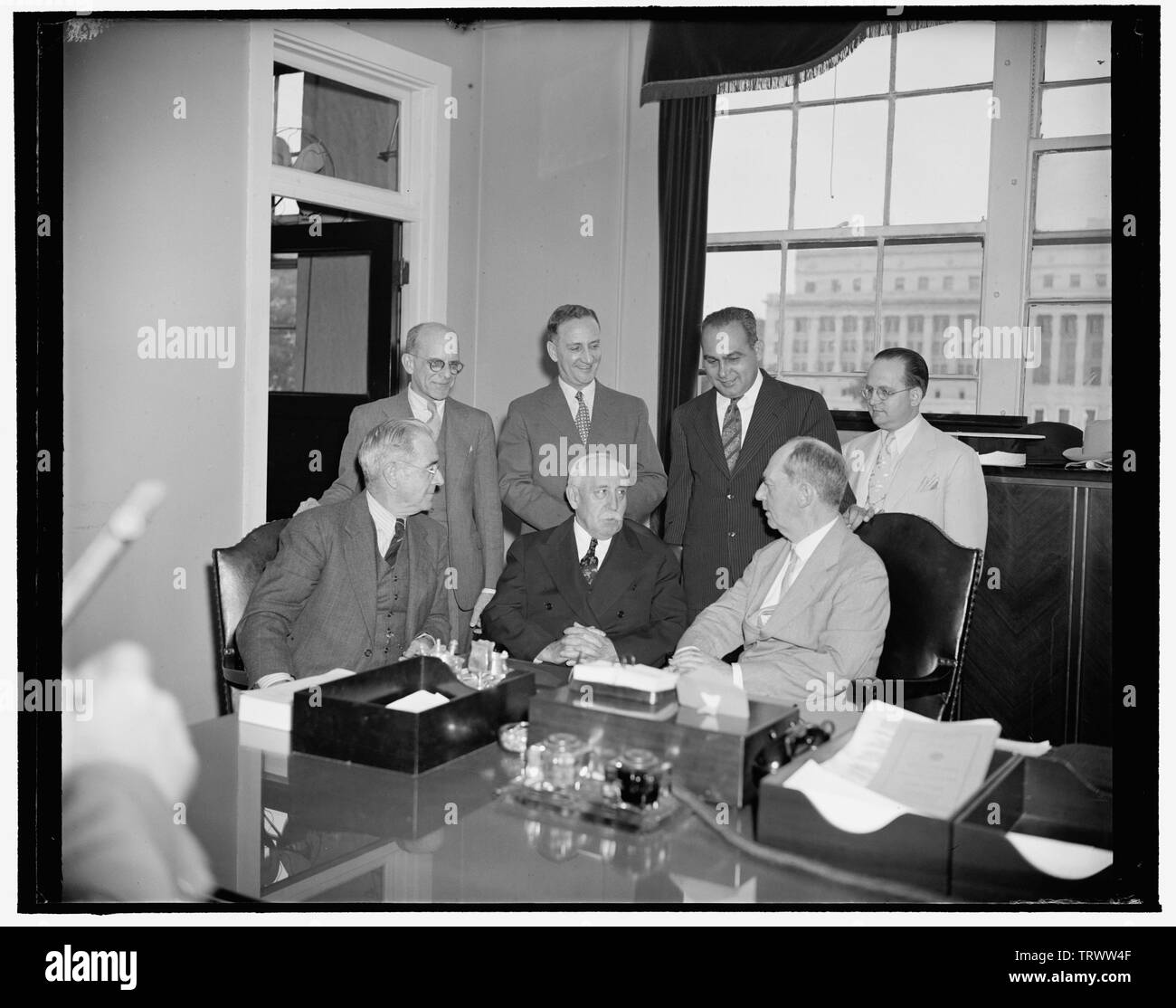 Admiral Leahy confers with Puerto Rican officials about new post as Governor. Washington, D.C., June 14. Admiral William D. Leahy, wh Stock Photo