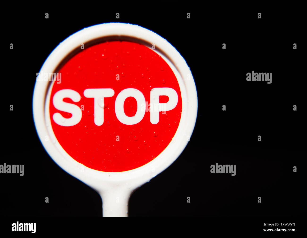 stop sign with water drops - Stock Image
