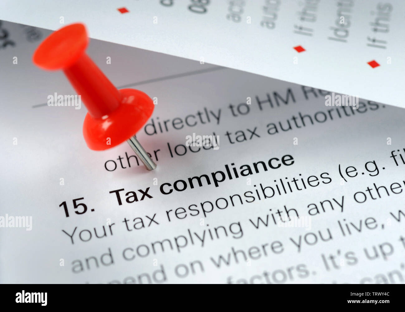 TAX COMPLIANCE LITERATURE WITH RED BOARD PIN RE TAXATION TAXES AVOIDANCE EVASION SELF ASSESSMENT HMRC ETC UK - Stock Image